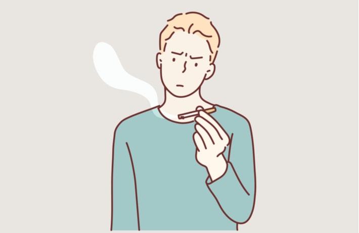 タバコを持つ男性のイラスト