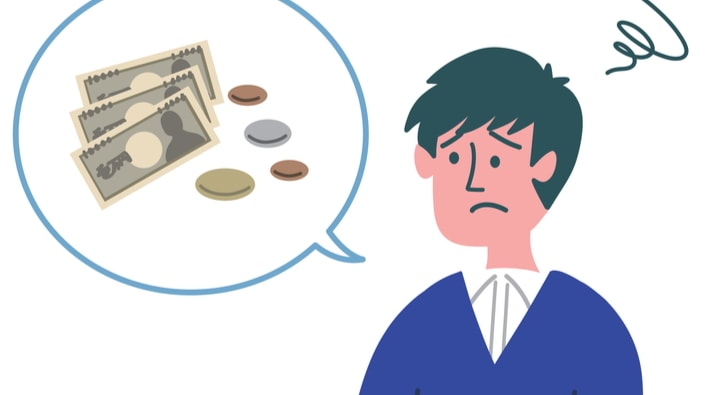 お金について悩む男性