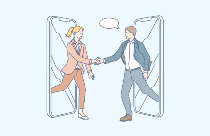 スマートフォンから飛び出して握手する男女