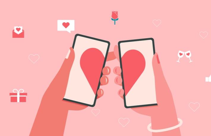 スマートフォンをもつ2つの手
