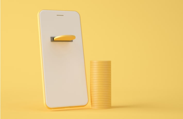スマートフォンとコインのイラスト